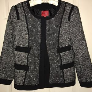 Boucle jacket with hidden buttons.